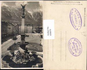 450079,Innsbruck Südtirolerplatz Brunnen Säule Bergkulisse