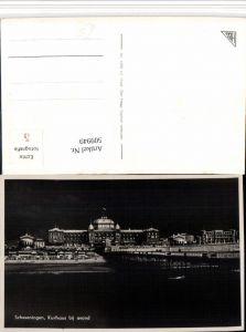 509949,Netherlands Den Haag Scheveningen Kurhaus bij avond Strand