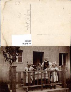 580818,Gruppenbild Familie auf Balkon Terrasse Sticken Mode Haarschleife