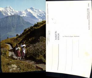 619124,Foto Ak Gündlischwand Wilderswil Im Alpengarten Schynige Platte Mönch u. Jungfrau Frauen Tracht
