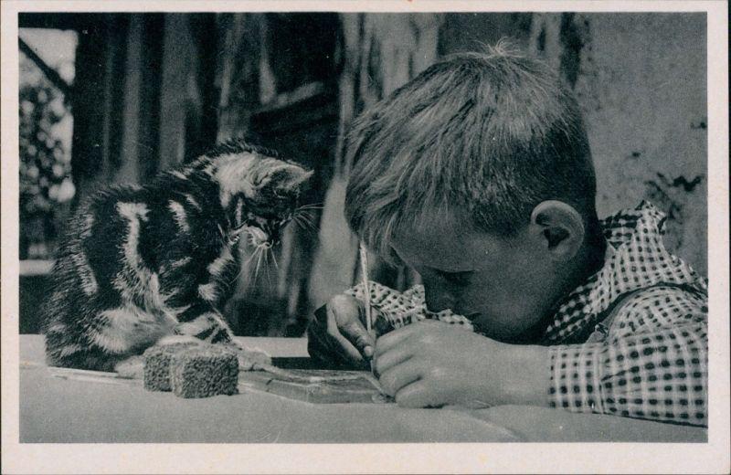 Ansichtskarte  Kind schreibt auf Schiefertafel, Katze schaut zu 1934