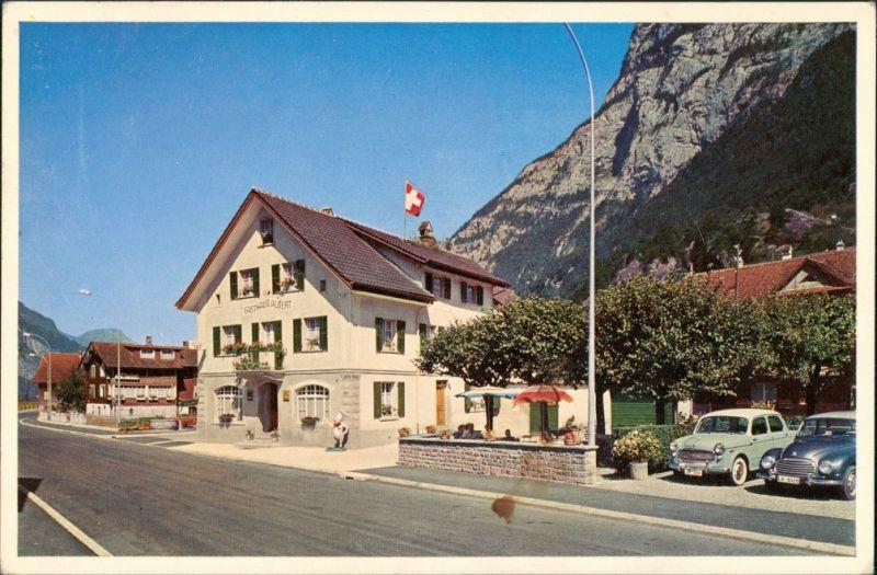 Ansichtskarte Erstfeld Gasthaus Albert, Strassen Partie, alte Autos 1962