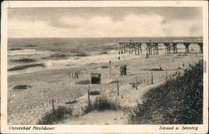 Ansichtskarte  Neuhäuser (Ostpreußen) Strand  und Seesteg b Rauschen 1934